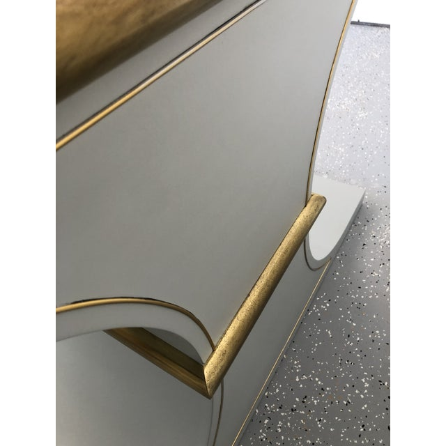 Beautiful console with brass accents and painted finish. Made in the 1970s.