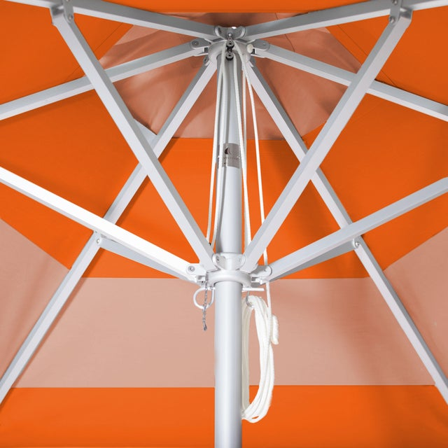 The Tuscan Sunset Market Umbrella is a 9' Hexagon in Aluminum. The canopy features a block stripe in Tuscan and French...
