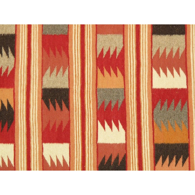 Here is an intriguing and decidedly modern Navajo style carpet - a Navajo kilim that was hand-woven of top quality wool in...