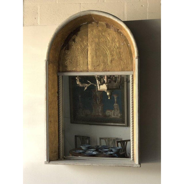 19th-C. Spanish niche mirror with a gilt finish at the top and sides. Height: 43″ Width: 27″ Depth: 6″
