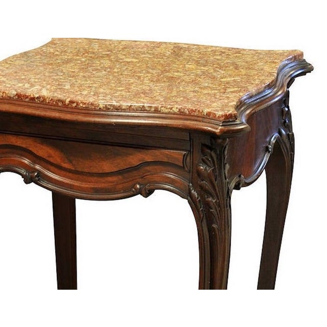Lovely restored French marble top stand with a sculpted top. Made in the early 1900s.
