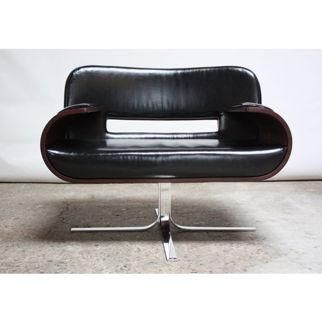 Rare Jorge Zalszupin Brazilian modern armchair composed of bent jacaranda arms and back with black leather seat, back and...