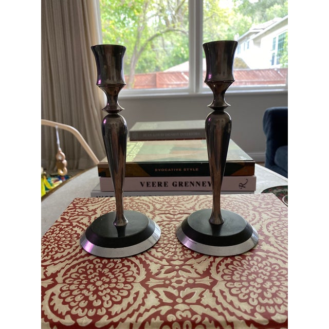 Beautiful Mid-Century Candlesticks that I believe are made out of pewter and black granite. Very modern and sleek with a...