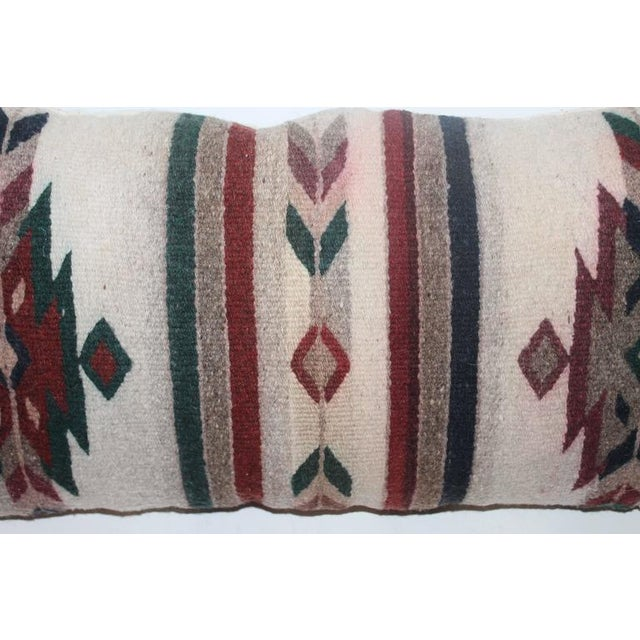 This is interesting and very colorful. We have one other similar pattern like this pillow. So you could have a pair if...