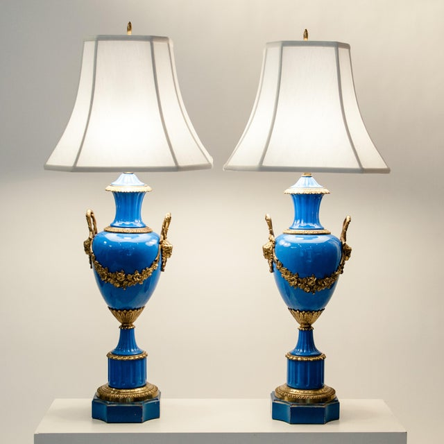 An antique pair of blue glazed porcelain lamps with solid brass design. These lamps are just amazingly beautiful and would...