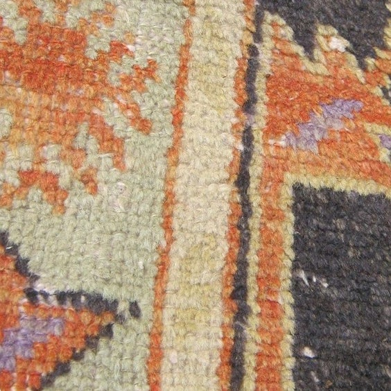 """A beautiful and worn Turkish Oushak rug. Lovely tones of rust, purple, brown, and taupe. 66"""" x 31"""""""