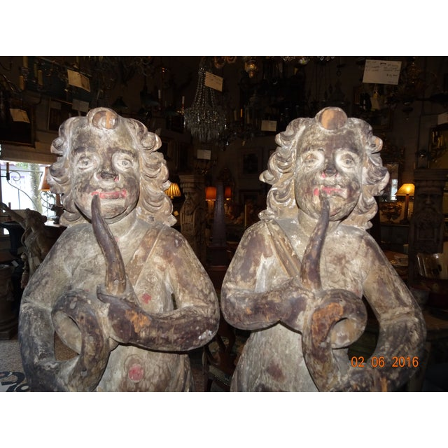 These cherubs are magnificent. They were part of a boiserie and have been mounted on a metal plinth. The wood carving is...