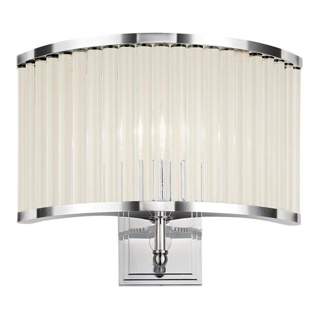 A polished chrome steel and glass curved wall light. Certification: IP20. Bulb: 1 X E14 3.5W LED 2100K