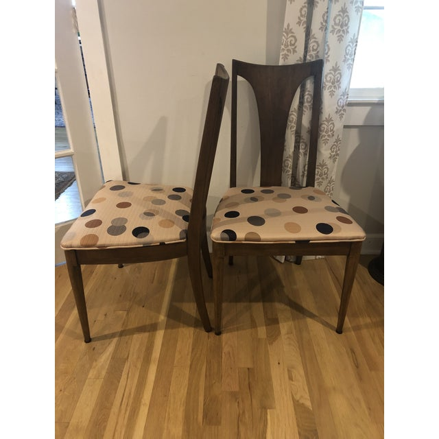 These chairs are by Lenoir, which is a division of Broyhill, and they are the Brasilia style. They are made of walnut and...
