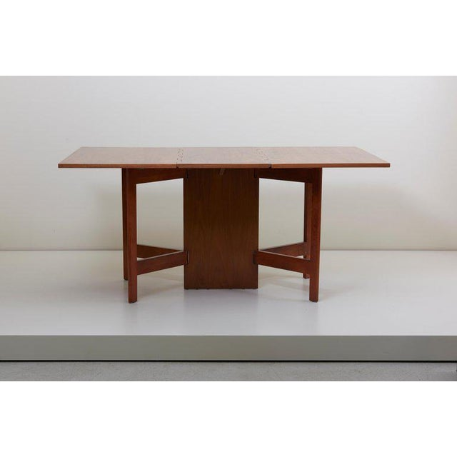 Classic 1950s gate-leg dining table in walnut by American designer George Nelson for Herman Miller. Excellent condition!!