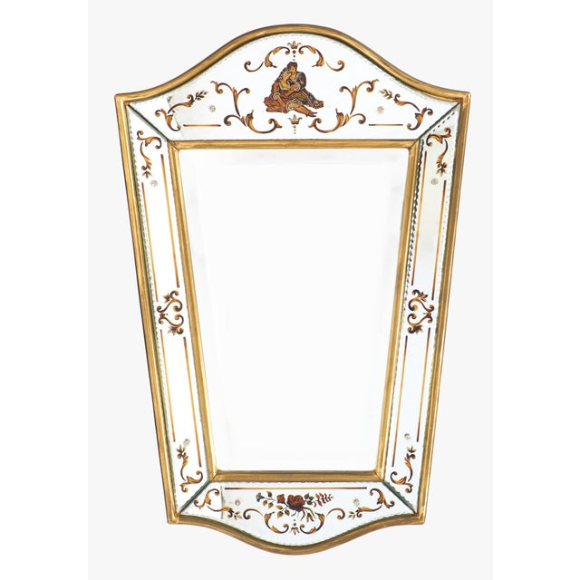 Vintage French églomisé́ and gold leaf wall mirror. Surrounded a central mirror and bordered with a gold leaf frame inside...