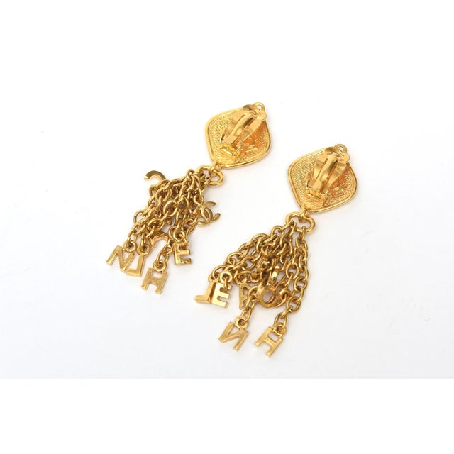 Chanel Vintage Chanel Pair of Gold Plated Charm Dangle Clip on Earrings For Sale - Image 4 of 10