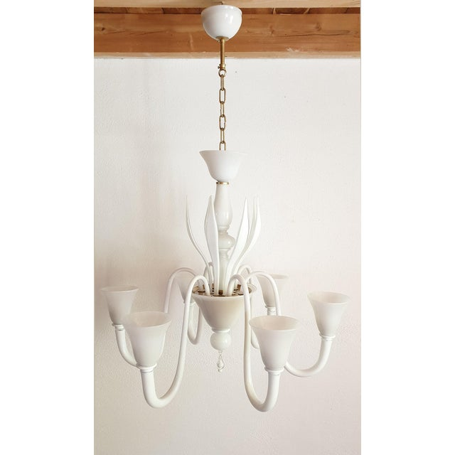 Large Mid-Century Modern Venini six-light chandelier, in white hand blown Murano glass. Italy, circa 1970s. The style is...