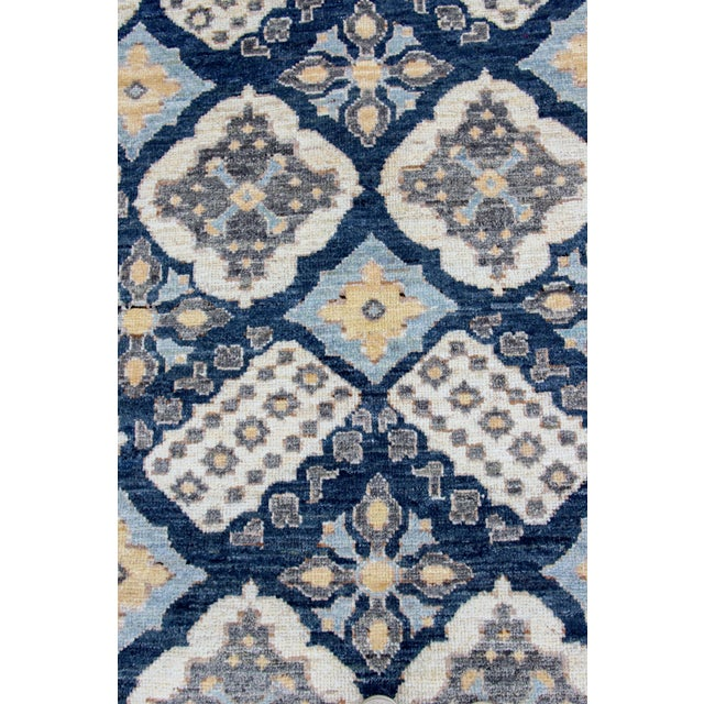 Hand-Knotted with hand-spun wool, woven in Afghanistan. This beautifully designed rug will be sure to stand out in any...