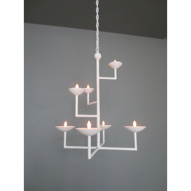 Seven cup and seven light rectangular chandelier. Center pole with crossbar at base has three L-Shaped extended arms....