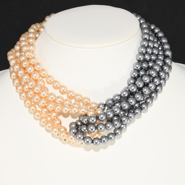 Kenneth Jay Lane necklace comprised of twelve strands of cream and gray hand knotted glass faux pearls. There are six...