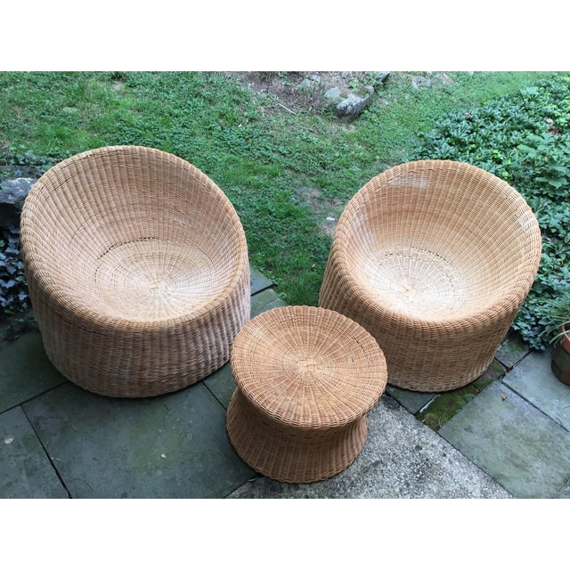 This is a rare set of 1960s wicker chairs and stool designed in Finland by Eero Aarnio. They were made in Hong Kong and...