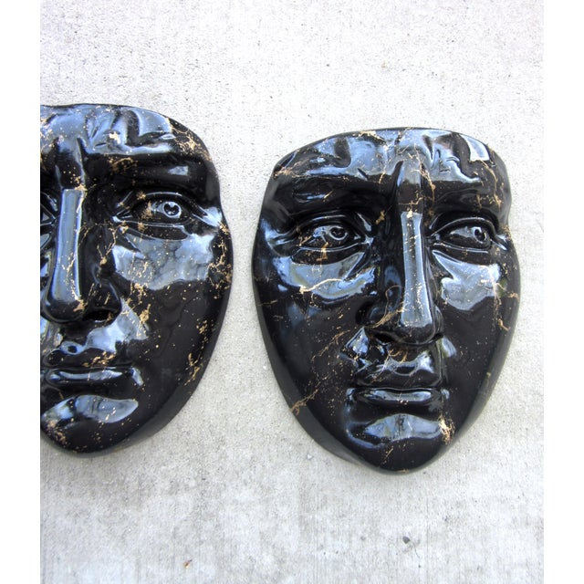 This is an amazing pair of sculptural, realistic face mask/mold wall art objects, done in plaster and painted with a black...