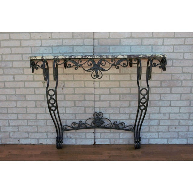 Antique French Victorian ornate wrought iron base console table with marble top.As is! Circa 1930.