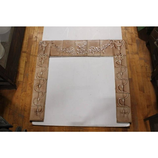 Early 20th century glazed porcelain tile fire place surround. Includes 17 tiles.