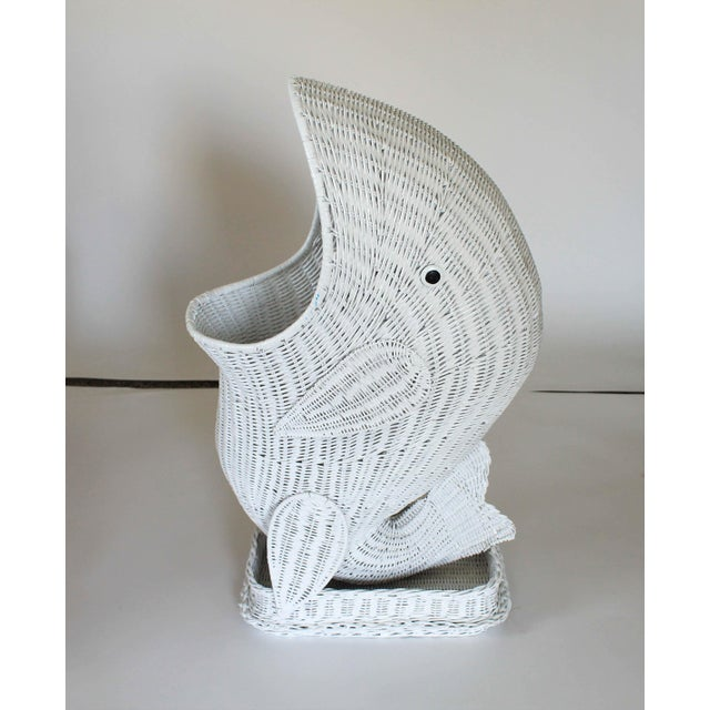 Decorative white vintage wicker whale basket. Could serve as a clothes hamper. No makers mark. Some age wear to wicker....