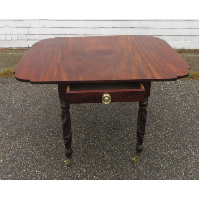 Antique American mahogany federal drop leaf table with acanthus carved legs . circa 1820's The table has one dovetailed...