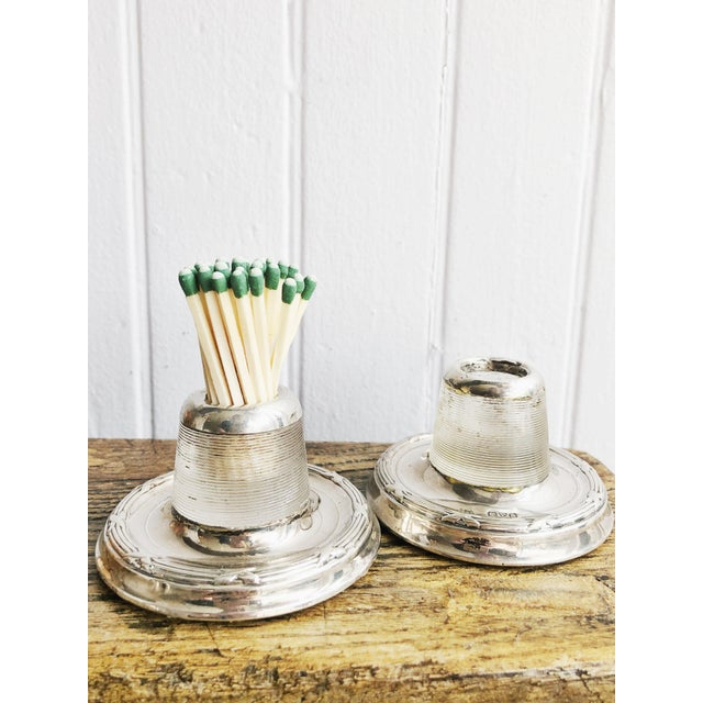 A matched pair of lovely antique circa early1900s English glass match strikers with sterling silver rim and base....