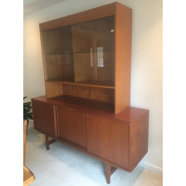 Teak Danish Modern Hutch and Sideboard with glass doors on the hutch. Approximately 45 years old and in mint condition.