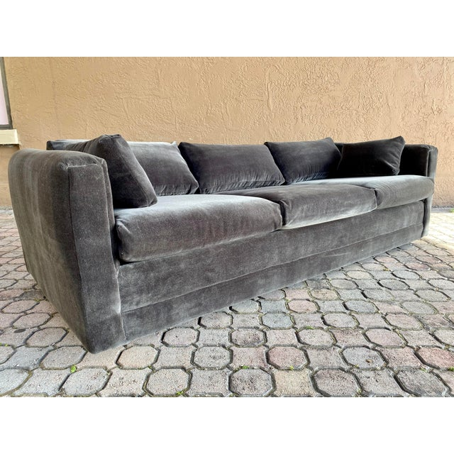 Beautiful newly restored gray velvet tuxedo sofa. Very comfortable to sink into and relax. The sofa stands on four rolling...