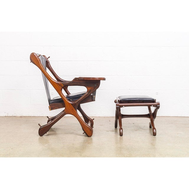 NOTE: Additional Don Shoemaker sling chairs available. This vintage mid century modern armchair was designed in the 1950s...