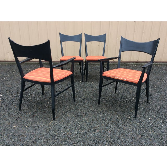 Great set of four dining chairs by Paul McCobb for Calvin Furniture. Set consists of two arm chairs and two side chairs....