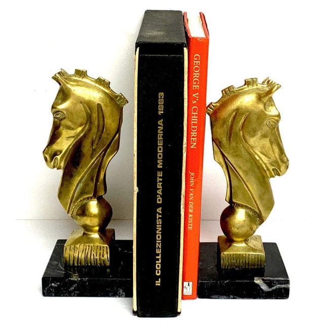 Pair of midcentury bronze and marble horse Motif bookends, Each one with stylized horse head, 8-inches high raised on a...