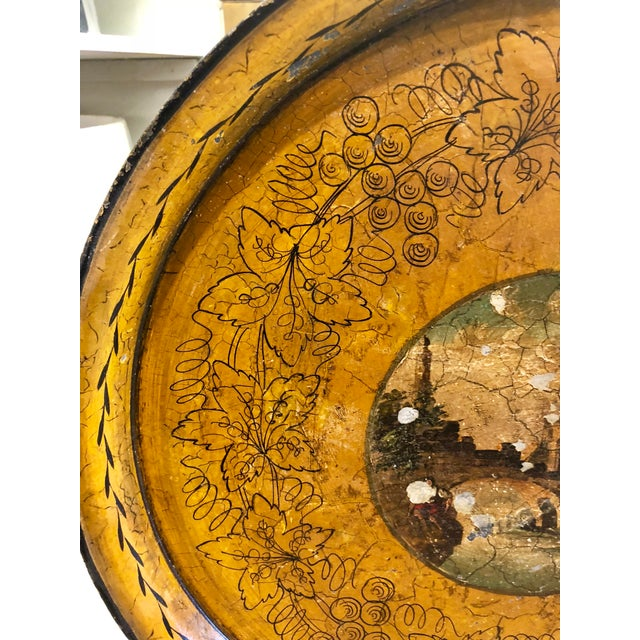 """Antique Round tole tray with castle scene in the center. Measures approximately 17 3/4"""" in diameter and 1"""" high"""