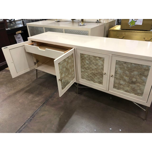 Unique materials and intriguing shapes give this beautiful buffet a truly captivating presence. A metal base with...