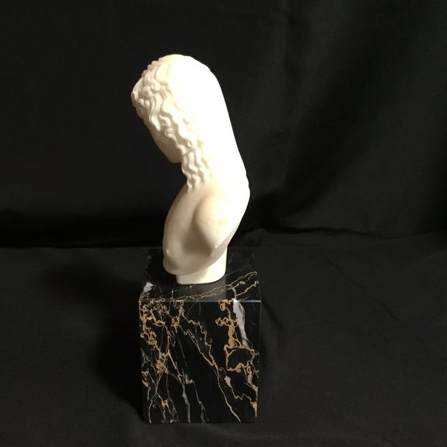 Marble statue of Eros - Greek god of love. Weighs around 7.8 pounds. Black marble base with veining lighter lines.