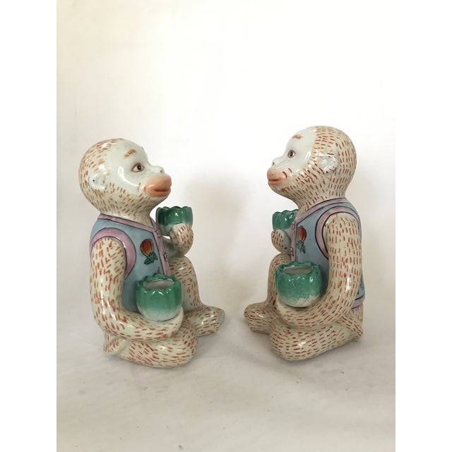 Cute pair of vintage Chinese Figurines / Bookends of Monkeys « Gardeners » seated, holding planters and wearing a floral...