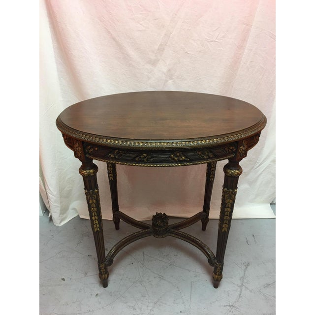 French mahogany oval table with gold painted ormolu, early 20th century.