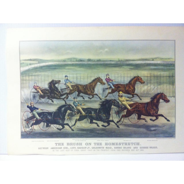 "This is a reproduction of a Currier & Ives color print that is titled ""The Brush on the Homestretch"". The print is dated..."