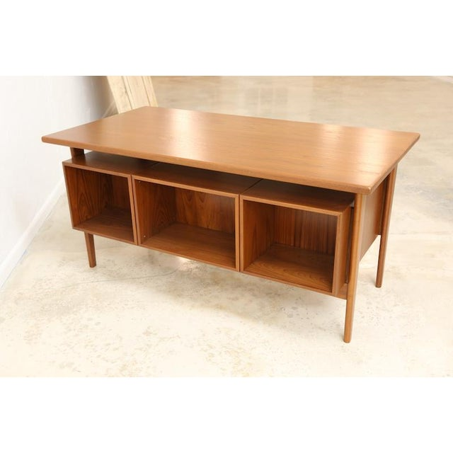This desk is of a unique floating drawer design of the mid-century Model FM 60 by Kai Kristiansen for Feldballes...