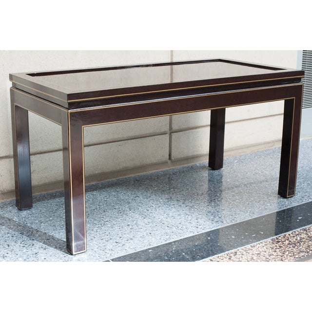 Coffee or cocktail table in a custom brown/ black finish with gold striping on the top, side and legs. This table can be...