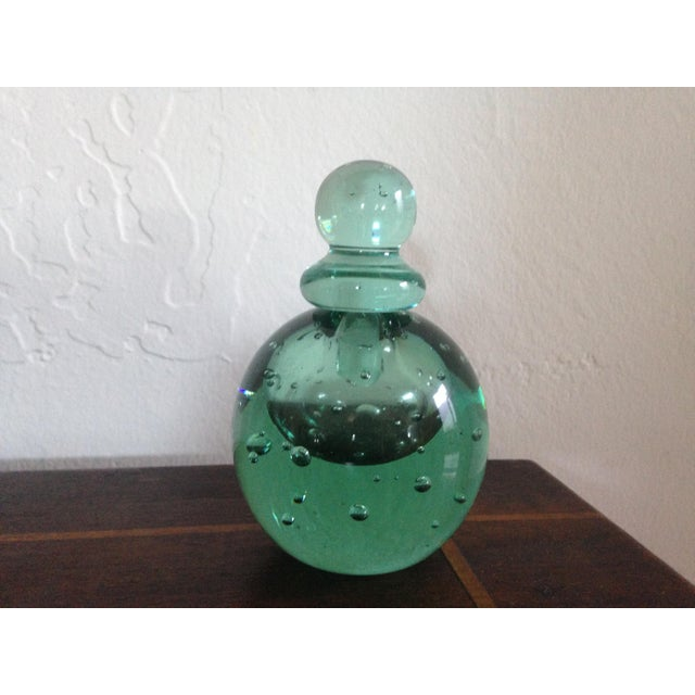 This is a reproduction of an antique perfume bottle from the Museum of Modern Art in New York. It is a beautiful shade of...