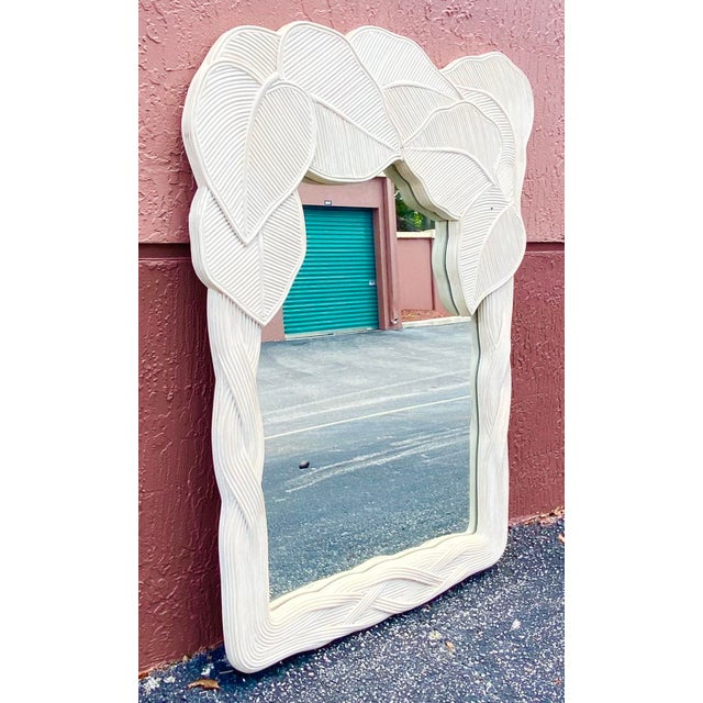 Stunning pencil reed wall mirror. Boho chic style with a wrapped leaves design. Contemporary cerused whitewash color for a...