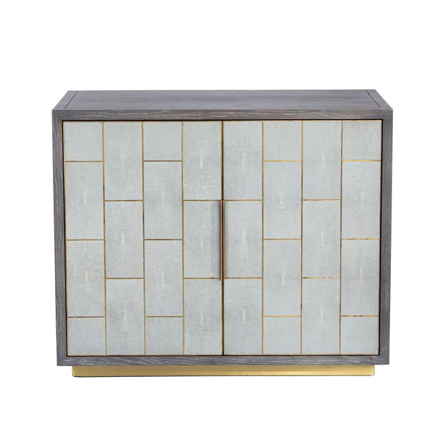 Evoking Hollywood glamour, the wood Fabienne Bar Cabinet boasts a light grey wash oak finish paired with light grey...