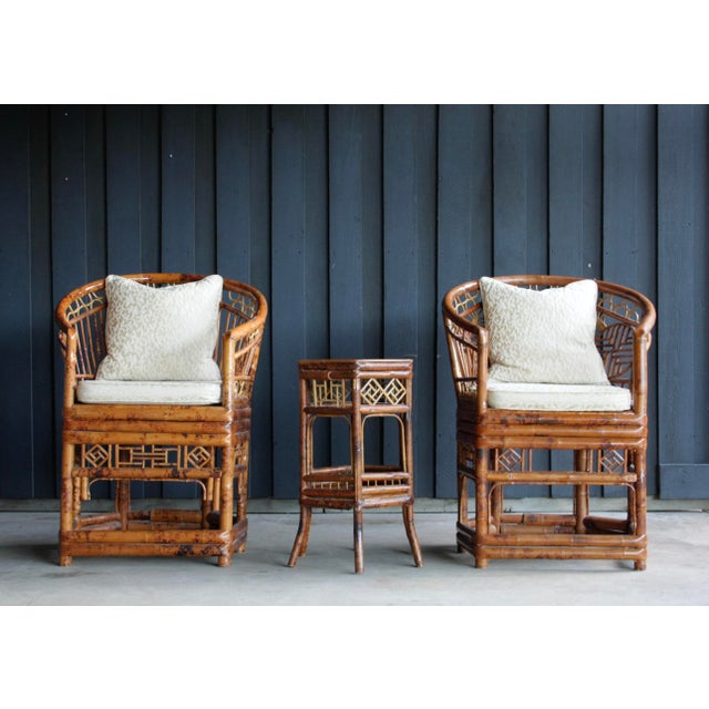 Stylish and desirable pair of Brighton Pavilion Chinese Chippendale style faux tortise shell rattan armchairs with...