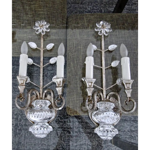 Pair of silver antiqued gilt iron sconces with crystal flower plus leaves and urn motif by Banci Firenze of Italy. Each...