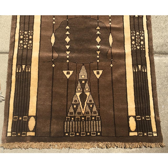 A rich-toned brown and gold-toned art deco style small rug. Lush and soft with a symmetrical overall pattern, perfect for...