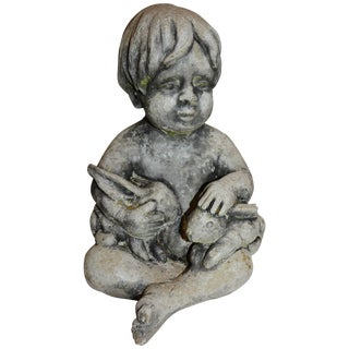 Midcentury Concrete Statue of Baby Holding Bunnies For Sale