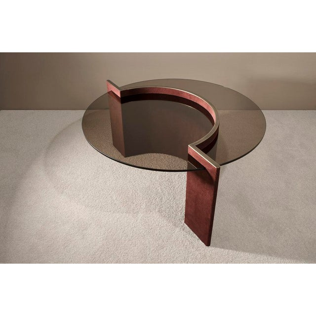 The Torus Coffee Table incorporates microsuede fabrics in an uncommon context. By wrapping bent plywood with this heavily...