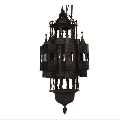 Large Moroccan brass hanging lantern, having domed top and domed finial at bottom, pierced geometric pattern, three...