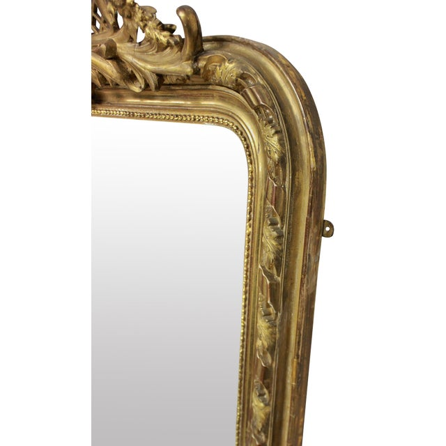 A fine French carved and water gilded overmantle mirror, with carved and gesso central cartouche.